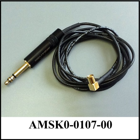 coiled black audio cord with large connector